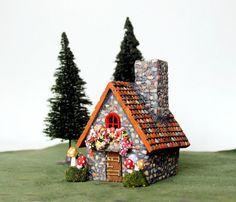 Garden Art, Fairies Garden, Fairy Gardens, Where Do Fairies Live, Stone Archway, Chalet Style, Mushroom House, Clay Houses, Blooming Flowers