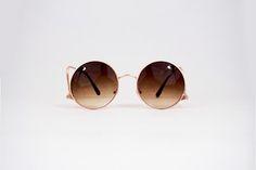 Óculos redondo com lente degradê
