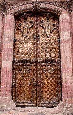 San Miguel de Allende, Mexico : each panel of these doors is made out of one piece of wood Cool Doors, The Doors, Entrance Doors, Doorway, Windows And Doors, When One Door Closes, Knobs And Knockers, Door Gate, Antique Doors