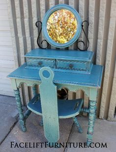Vintage Vanity with Chair & Mirror, in Sea Blue with Black glaze accenting many detailed areas. Original color of piece was a red-orange, which peaks through in distressing.