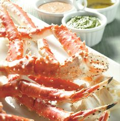 Crab legs are so fun for small dinner parties. Gather a group of friends around and serve them crab legs with a lots of different dipping sauces. Pass some crusty bread too.