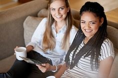 Shot of two young friends having coffee while using a digital tablet together - stock photo #1338327