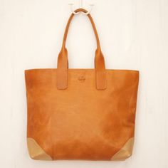 Obsessed with this fair trade leather tote, handmade in Uganda by women being paid fair wages. <3