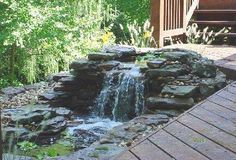 Easy Backyard Water Features | ... over river rocks into a never ending collecting pool of water water
