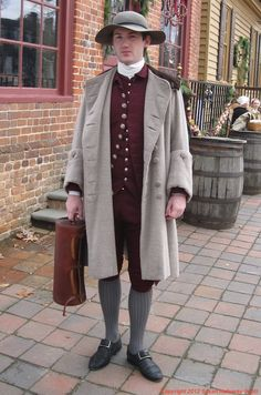 Christmas in Colonial Williamsburg, 2012: Tailor's apprentice Michael McCarty. More: http://twonerdyhistorygirls.blogspot.com/2012/12/day-vchristmas-in-colonial-williamsburg.html