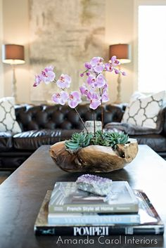 orchids and succulents in wooden bowl