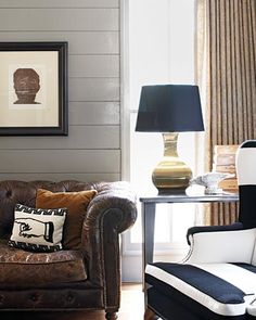 worn, tufted leather chesterfield sofa, brass table lamp from crate and barrel, broad striped wing back chair.  Kimberely Renner.