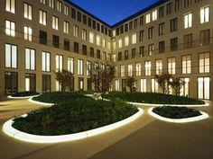 """Planted """"islands"""" with LED-backlit bordering made of DuPont™ Corian"""