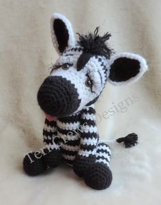 *Please note, this listing is for a PDF format crochet pattern to create a Zebra toy/softielike the one shown. Finished items are not included in this listing.**  ***PDF PATTERN, NOT A FINISHED PROJECT***  This sweet striped fellow works up quickly with your favorite worsted weight yarns. Uses basic crochet stitches and a size G (4.24 mm) crochet hook. You will need to know how to crochet in the round to finish this project. Pattern includes detailed written instructions (in English), a ...