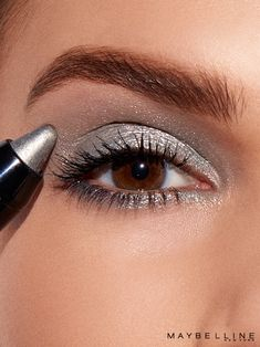 Makeup Trend Alert: Metallic eye! This fall recreate this silver smokey eye look with Maybelline's Color Tattoo Crayon in 'Grey Crystal'. Want a softer look? Click through to see the other metallic eyeshadow shades from gold to pink to purple.