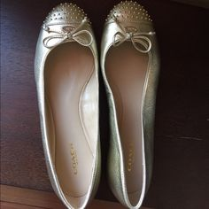 Shoes Gorgeous and soft.  Gold flats from coach perfect for walking with style.  Brand new never used. Coach Shoes Flats & Loafers