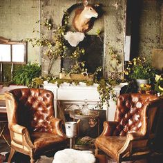 De-constructed, tufted leather chairs, antlers on the mantel, mismatched rugs, and an oil painting as a fireplace screen. Fall Color Schemes, Interior And Exterior, Interior Design, Interior Ideas, Garden Chairs, Home And Living, Small Living, Living Rooms, Decoration