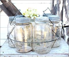 I have one of these...  could put utensils in each jar and set in the middle of the table.