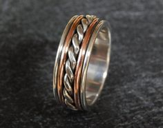 This is my most elaborate wedding band. Counting the two wires in the twist, and the sheet on the bottom, there are a total of 7 pieces fused together.