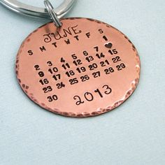 Special Day - Calendar Key Ring - Hand Stamped Copper Calendar Keychain.  I want the full name OCTOBER on it, and the month was only a 5 week month so it should fit :D remember, our anniversary was 10 October 2012. I like this copper colour and the fonts on this round key ring :)