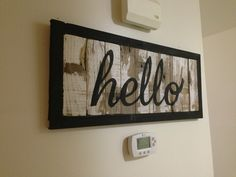 Sign made from old deck boards.  Planks are attached to each other using wood biscuits and glue.  Wooden pegs made from a dowel rod were used to construct the frame and secure the planks to the frame.