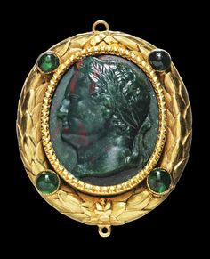 Oval cameo, heliotrope, mounted into a golden pendant designed as laurel wreath with four emeralds in cabochon cut. Portrait head of the Roman Emperor Vespasianus with laurel wreath facing left. Probably German, about 1700 A.D.