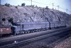 Allegheny Eastern: Photo of a set of Baldwin centipedes. The 3000 HP 12 wheeled giants ran in permanent pairs on the PRR, creating a 6000 HP locomotive long before such beasts became common. The two units have been repainted in freight striping and assigned classification BH50. With the removal of their trouble prone turbochargers each unit only developed 2500 HP.