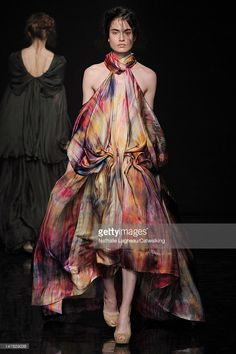 A model walks the runway at the Yiqing Yin Autumn Winter 2012 fashion show during Paris Haute Couture Fashion Week on July 4, 2012 in Paris, France.