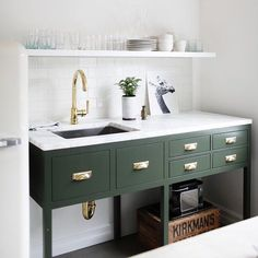 A small kitchenette delivers big impact when the focus is on timeless, traditional details and amenities. This Seattle, WA office kitchen, designed and styled by @katiehackworth, uses our historically-based Bevel Edge Pulls in lacquered brass to bring warmth to a functional space. Link in profile to shop these pulls and see more of Katie's workspace. Photo by @belathee #RejuveSpotted #kitchenette #kitchenhardware #H2designandbuild