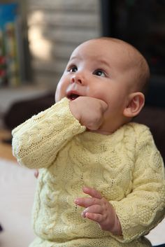 Ravelry: Baby's 1st Cable Sweater pattern by Fiona Ellis