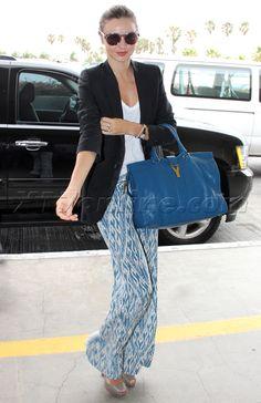 Miranda Kerr in a Stella McCartney blazer, flowy printed pants by Joie, Peep toe Christian Louboutins, & a YSL bag.