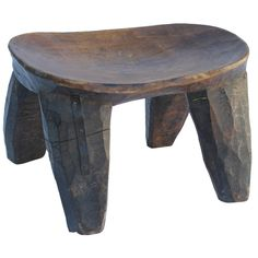 Carved African Stool to pair with other John Hutton Armchair