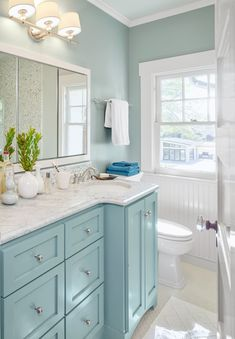 Bright Ideas for a Colorful Whole House Remodel A shared bath on the second floor mingles a traditional beadboard wainscot and a paneled door with polished finishes like a marble-topped vanity bathroom bathroomideas bathroomvanity