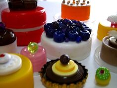 Plastic Lids turned into cakes using buttons and beads as decorations.  Great for a bakery role playing at Kindy.