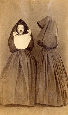 [Portugal/Azores, early 20th century] manto - Two women dressed in cloaks, one facing the camera http://75.150.122.156/newbedphoto/default.asp?IDCFile=DETAILSL.IDC,SPECIFIC=186745,LISTIDC=PAGEL.IDC,DATABASE=61009029,