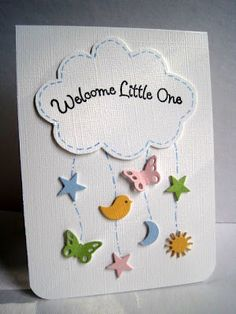 handmade baby card from Im in Haven: CAS-ual Fridays 64...The Sky ... stictched cloud with sentiment ... punched baby ikons hanging from it like a mobile ... luv it!!