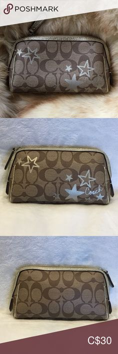 """Coach heritage star 🌟 signature cosmetic purse Coach stars in metallic gold on the front. PVC fabric Chocolate brown lining 3 interior pockets Zippered closure with brown leather pull 4.5"""" tall x 7.5"""" long x 2"""" wide Coach Bags Cosmetic Bags & Cases"""