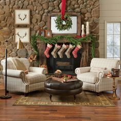 Love this Christmas mantle...especially the plaid Christmas stockings, but also the cedar garland, and the hanging wreath:) Wonder what they used for candlestick holders as I wouldn't mind mimicking that.