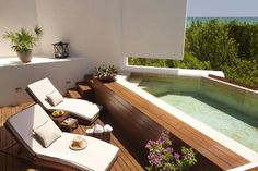 A private deck and plunge pool are included in the deluxe oceanview beach suite.