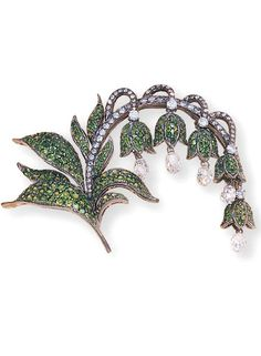 A TSAVORITE AND DIAMOND LILY OF THE VALLEY FLOWER BROOCH