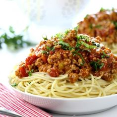 This is the BEST Homemade Pasta Sauce! Made with ground turkey or beef, this rich tomato sauce is perfect over spaghetti or in lasagna!