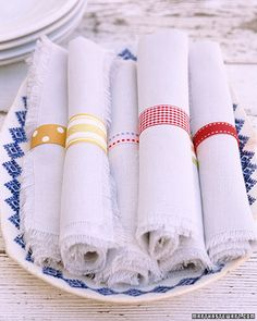 Set your table with napkin rings as unique as your guests. For each ring, fold a 6-inch length of fabric ribbon in half, right sides facing, and sew ends together with a 1/4-inch seam allowance. Turn the rings right side out, and slip them around rolled napkins.