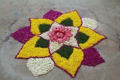 Big list Flower Rangoli Designs ideas and pictures for this ganesh chaturthi or any other Indian festivals. Learn flower rangoli designs for competition with flowers. Simple Rangoli Designs Images, Rangoli Designs Flower, Small Rangoli Design, Rangoli Patterns, Rangoli Ideas, Rangoli Designs With Dots, Rangoli Designs Diwali, Flower Rangoli, Beautiful Rangoli Designs
