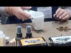 Wendy Vecchi Demo! she stamps on a plastic that can be used to form flowers.