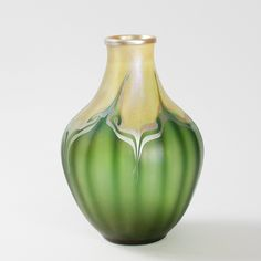 Favrile cream and green glass vase with silver iridescent pulled feather decorations by Tiffany Studios, NYC, USA