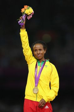 Gold medalist Meseret Defar of Ethiopia poses on…