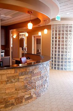 I do not care for the glass block, but the stone façade on front desk is nice. Medical Office Interior, Optometry Office, Dental Office Decor, Medical Office Design, Front Office, Front Desk, Future Office, Chiropractic Office Design, Office Waiting Rooms