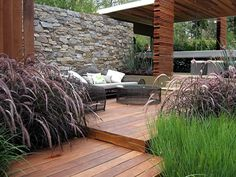 Beautiful outdoor space.  I love the rock wall!