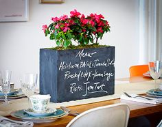 This handy chalkboard planter is a beautiful centerpiece — and self-watering!