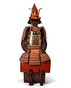 A black, gold and red-lacquer armor with a kawari kabuto, Edo period (17th-18th century) © 2002-2009 Bonhams 1793 Ltd