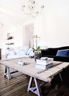 An old barn door makes a great coffee table top! Just put it atop a couple sawhorses (which you can make out of pallets, see our DIY desk video on our DIY board)