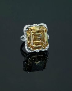 An impressive 41.34 carats fancy brownish yellow diamond and diamond ring, by Carnet