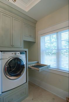 Lots of smart ideas in this laundry.  Drawers for laundry, I wud make a little deeper. Great drying drawer with rod above and rod over sink for hand washed items, might be better for another hanging drawer, don't hang on hangers most hand washed items