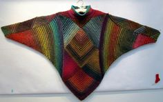 Mitered diamond panels are featured in this poncho. The pattern offers suggestions for alternate sleeve patterns. Crochet Poncho With Sleeves, Knitted Poncho, Knit Or Crochet, Knitted Shawls, Crochet Shawl, Crochet Vests, Crochet Cape, Crochet Edgings, Crochet Motif