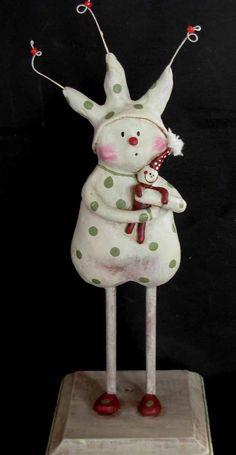 Vintage style sculpted folk art snowman with doll. Boy Howdie Folk Art